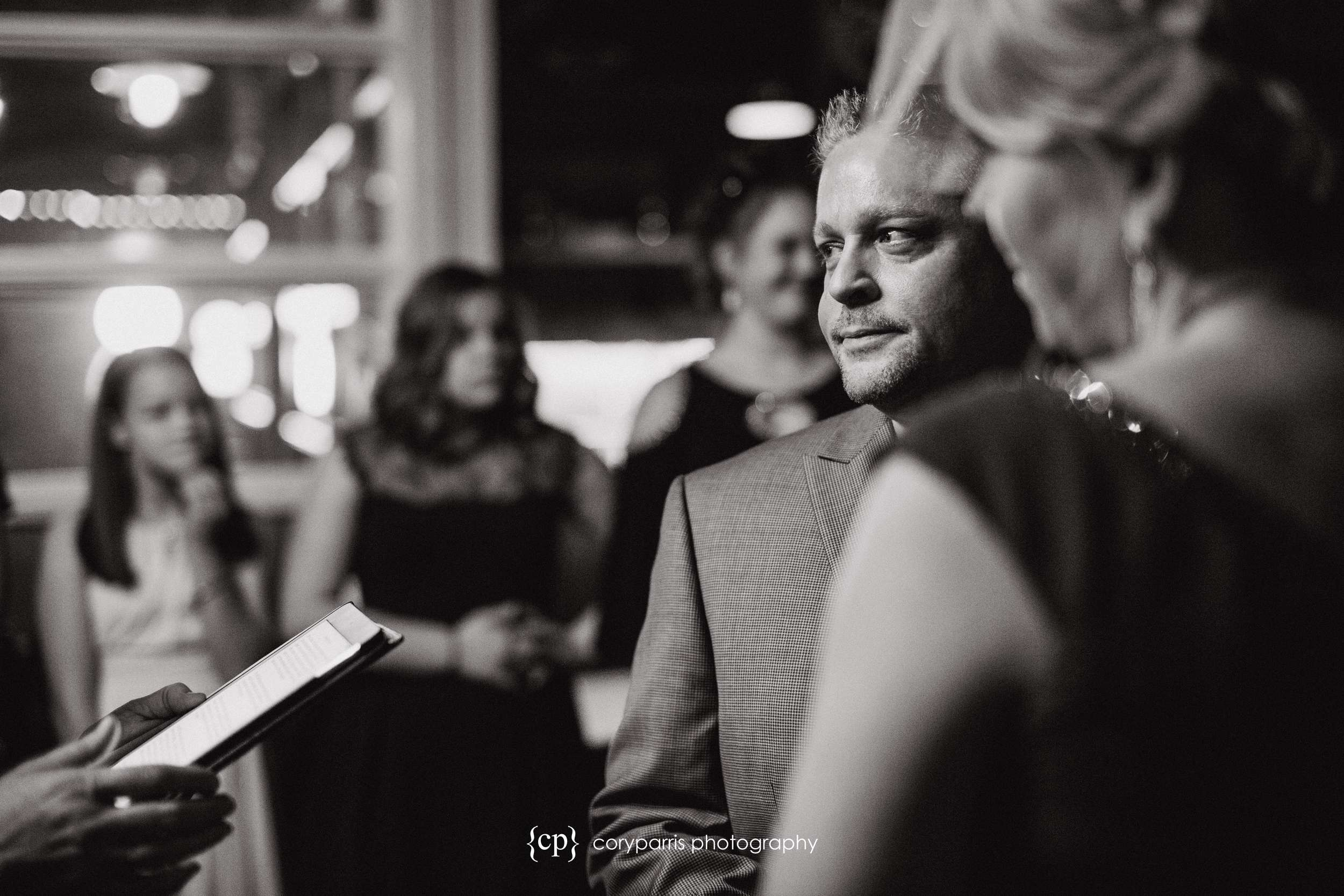 Jeff, the groom, during the wedding ceremony at Beecher's Loft
