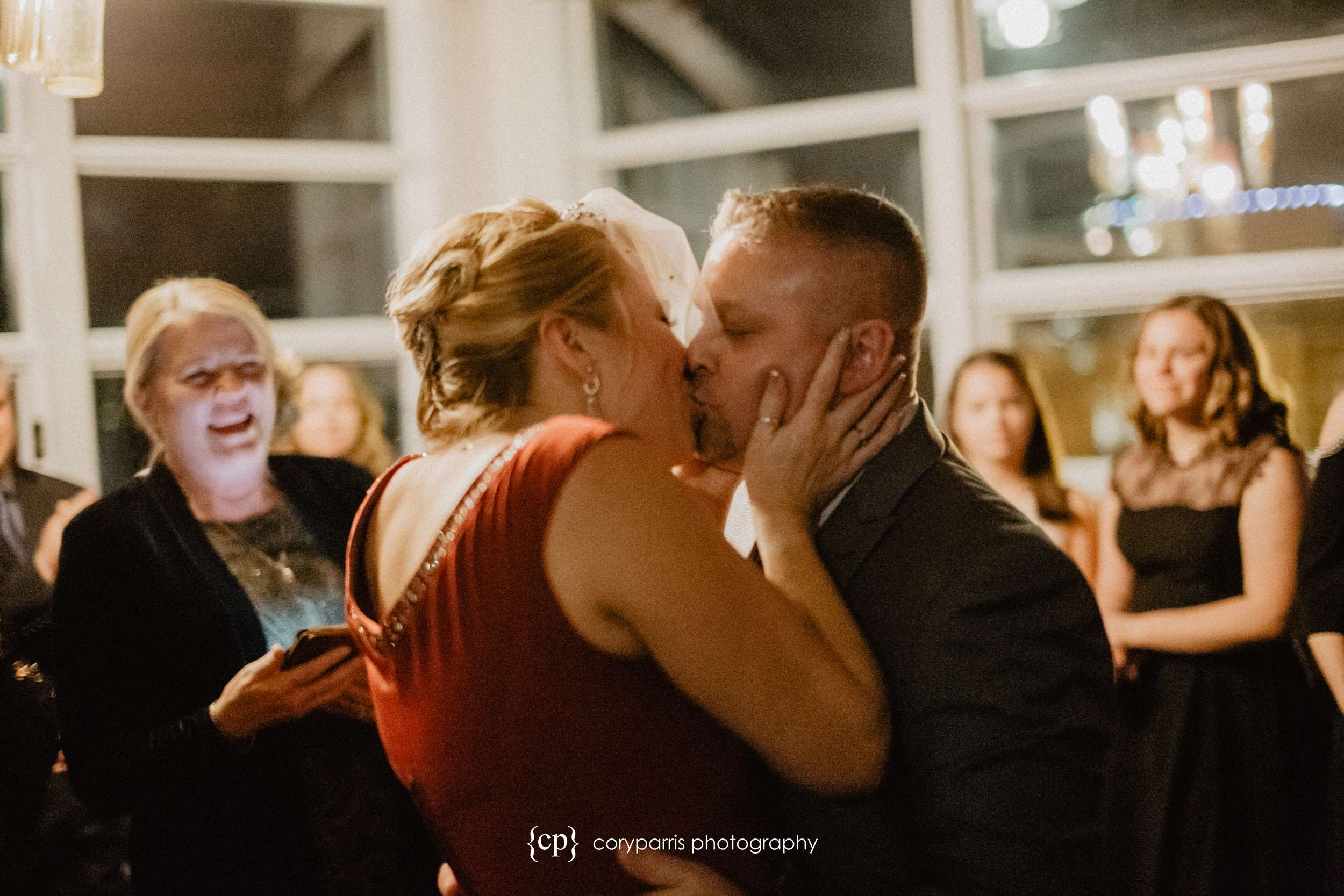 First kiss at a Seattle wedding photographer