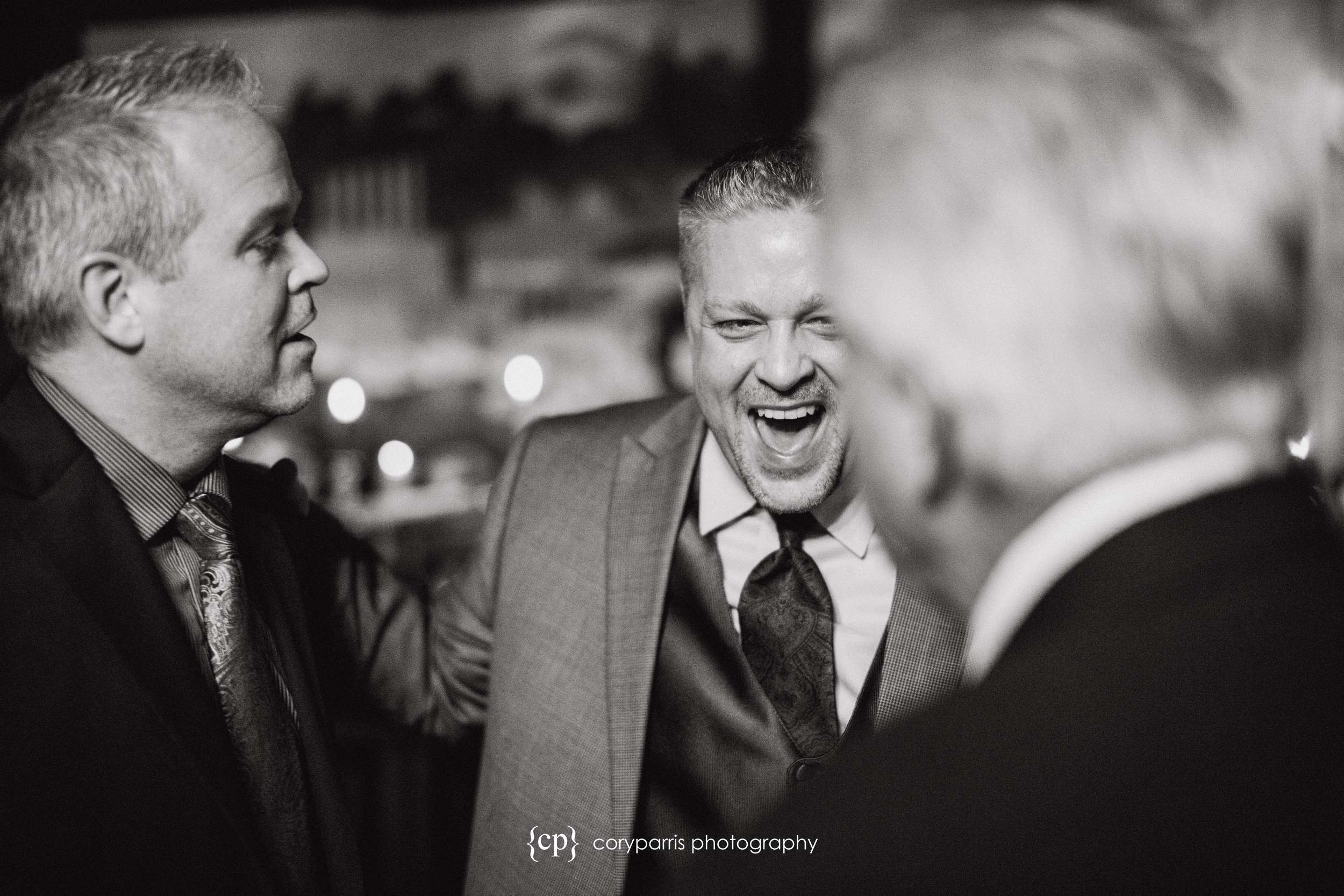 Groom laughing Seattle wedding photography