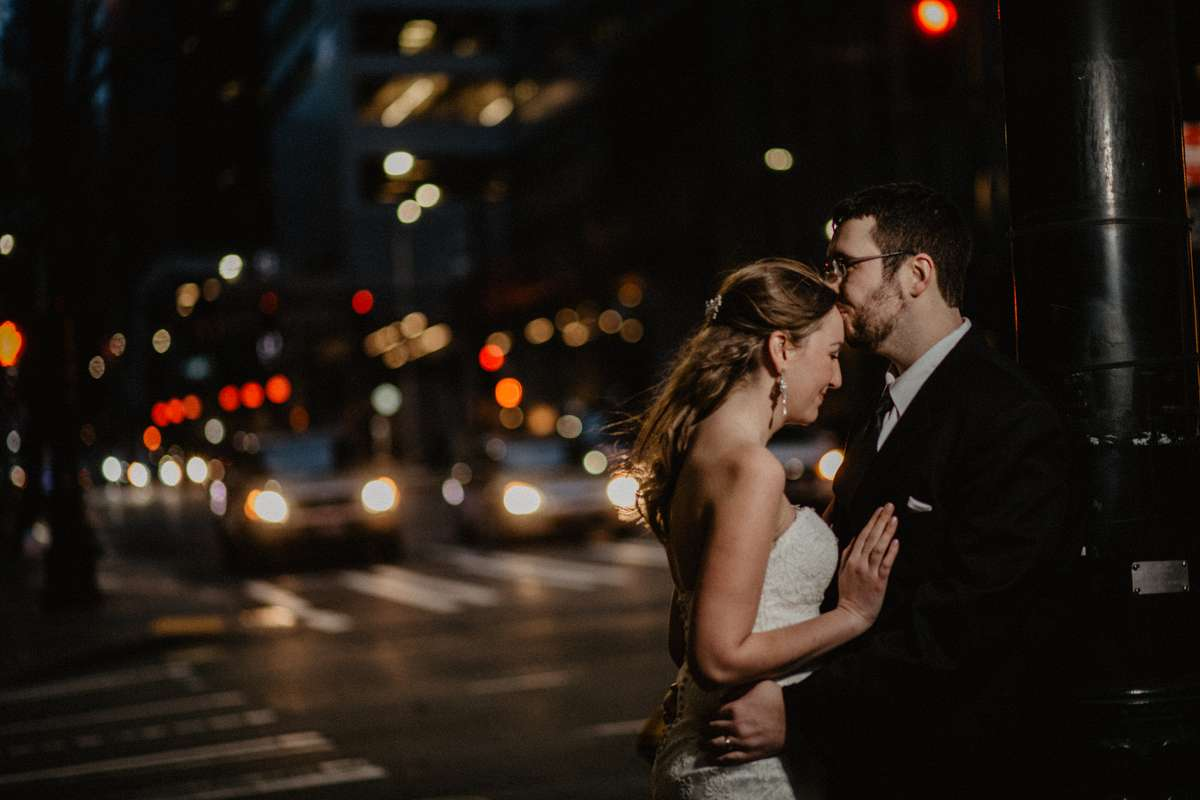 Portrait of Emily and David at night on the streets of Seattle after their Seattle Courthouse wedding. I love combining flash and the city lights.