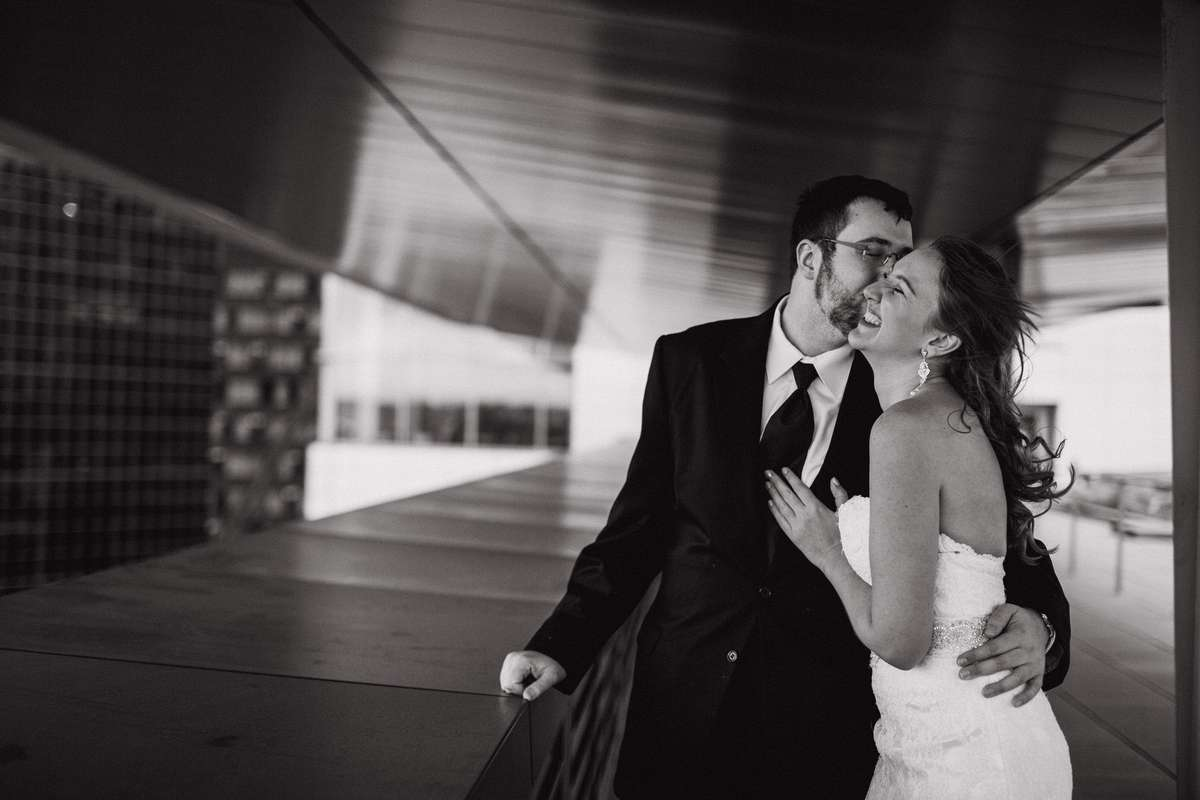 Emily and David laughing on the rooftop of the Seattle Municipal Court just before their wedding.