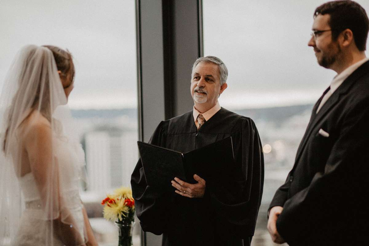Seattle Judge McKenna marrying Emily and David.