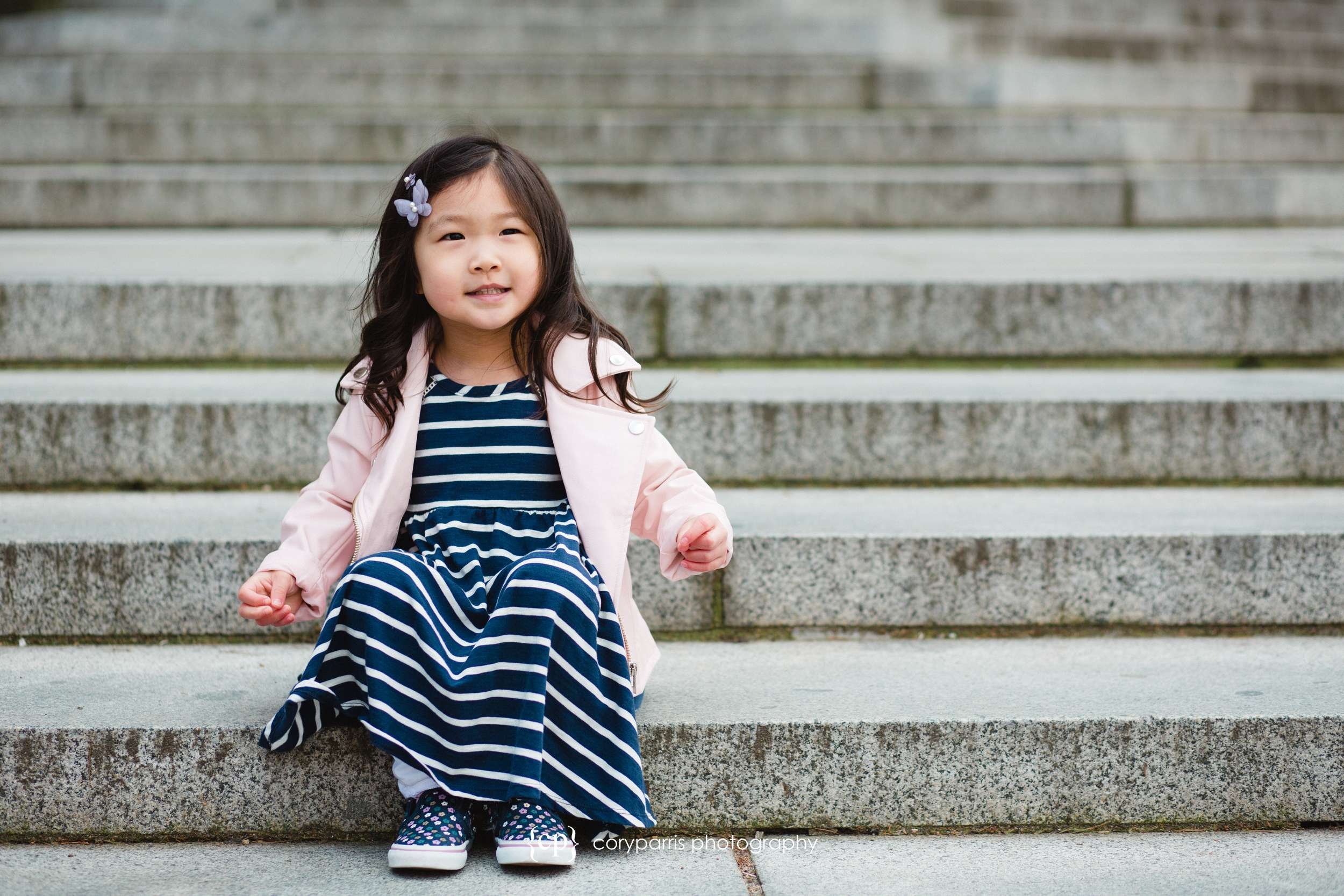 Little girl sitting on the stairs at the University of Washington