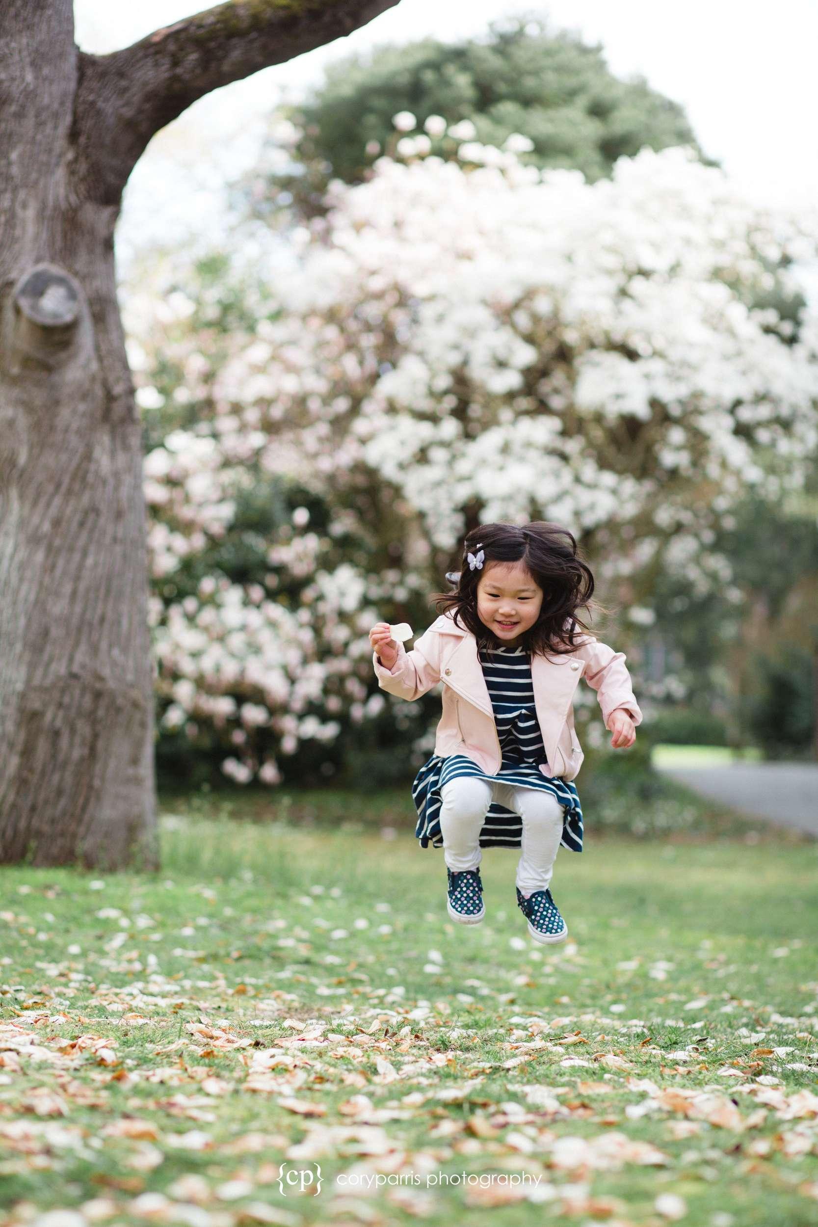 Jumping little girl portrait