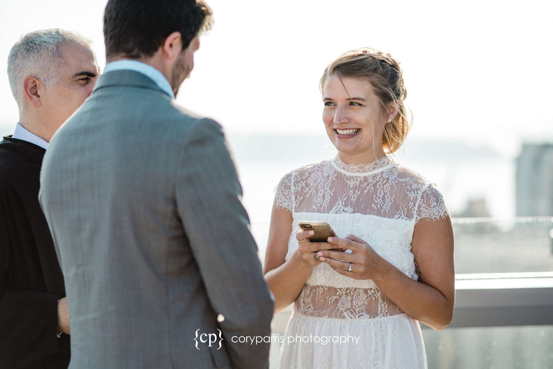 I love how Angela is looking at Jason as she says her vows that she had on her phone.