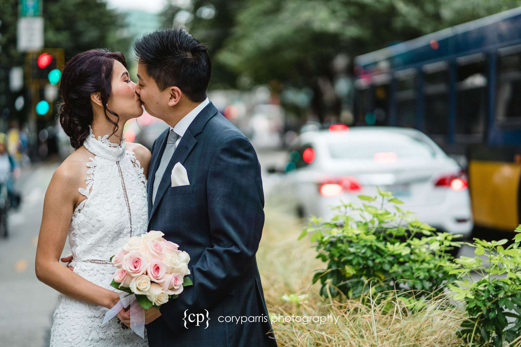 Cindy and Alex's portrait on the streets of Seattle after their elopement at the Seattle Courthouse
