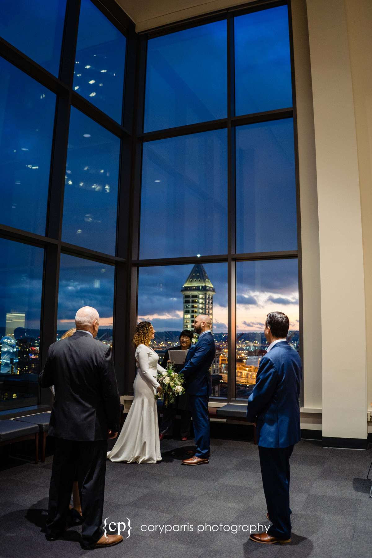 What a cool place to get married with the view of Seattle behind the couple.