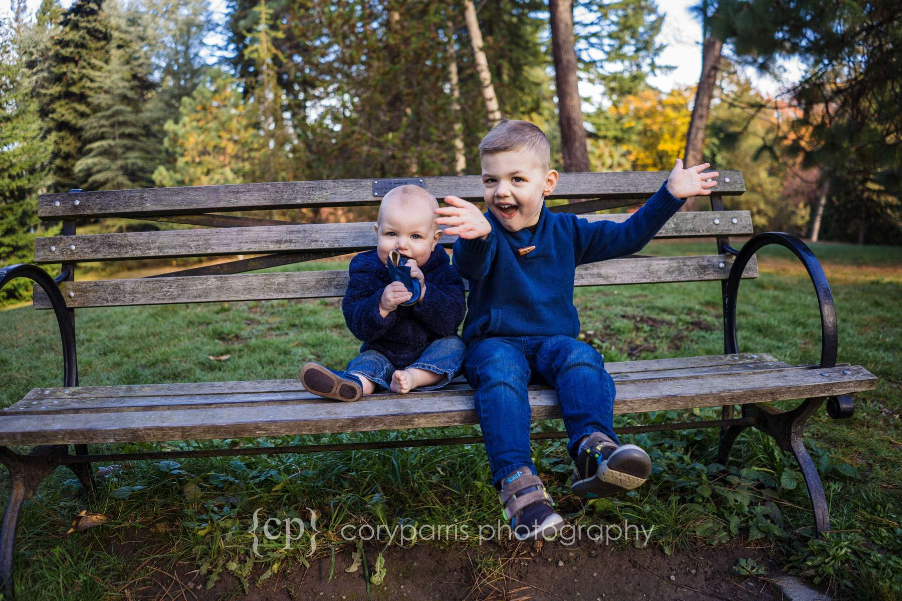"I sometimes love the ""other"" photos more than the perfect portraits. Here is a photograph with one kid chewing on his shoe and the other having a overabundance of personality. It's perfect in it's imperfection!"