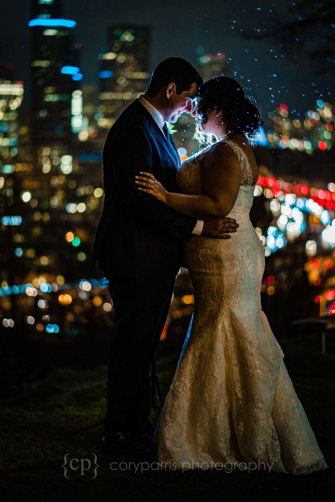 Hillary and Blake venturing outside in the rain for portrait with the amazing view of Seattle at night from Jose Rizal Park. Very cool!