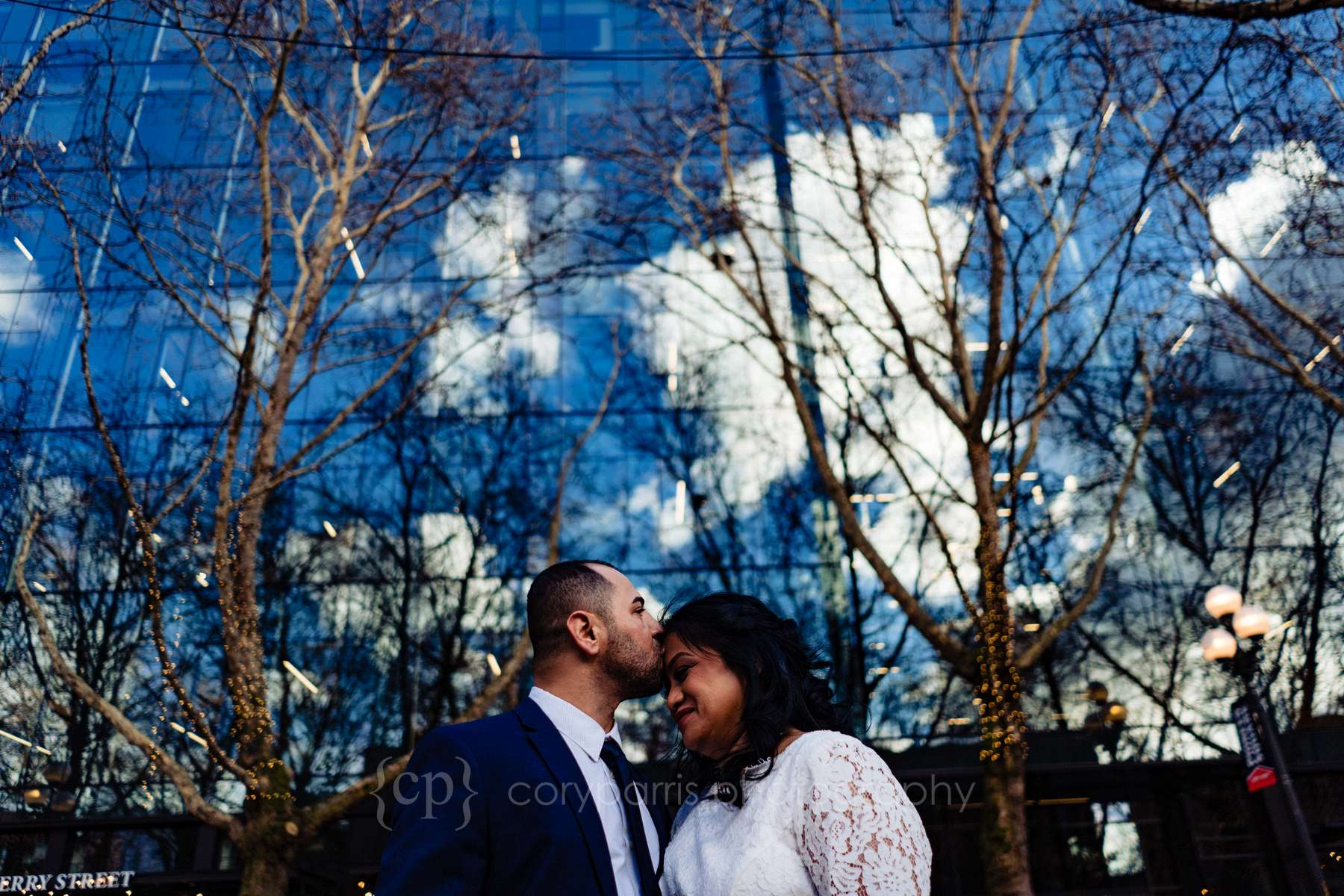 Christina and Yad at Occidental Square before their elopement at the Seattle Municipal Court.