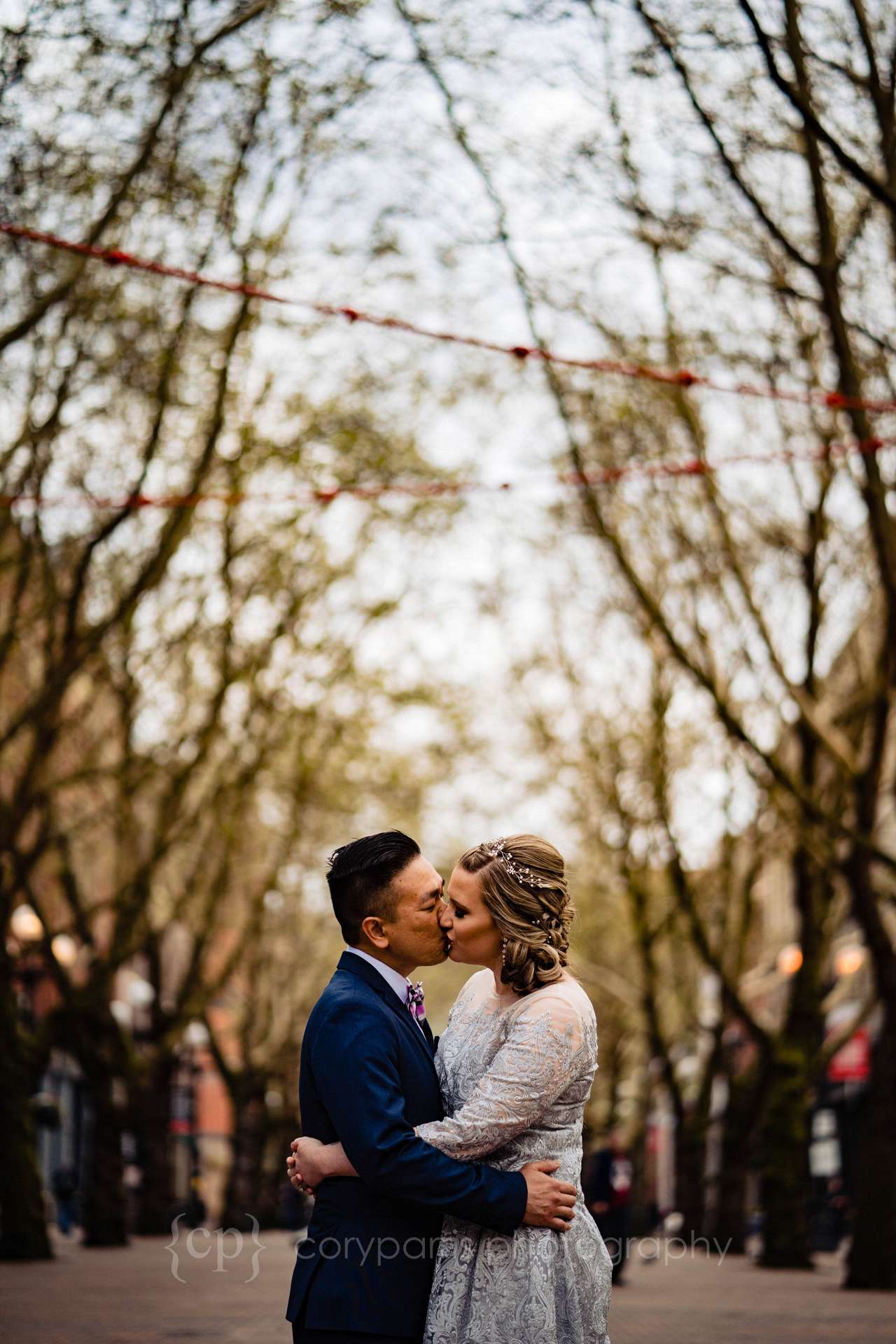Audrey and Clifton walked with me to be photographed at Occidental Park before their wedding at the Seattle Municipal Court.