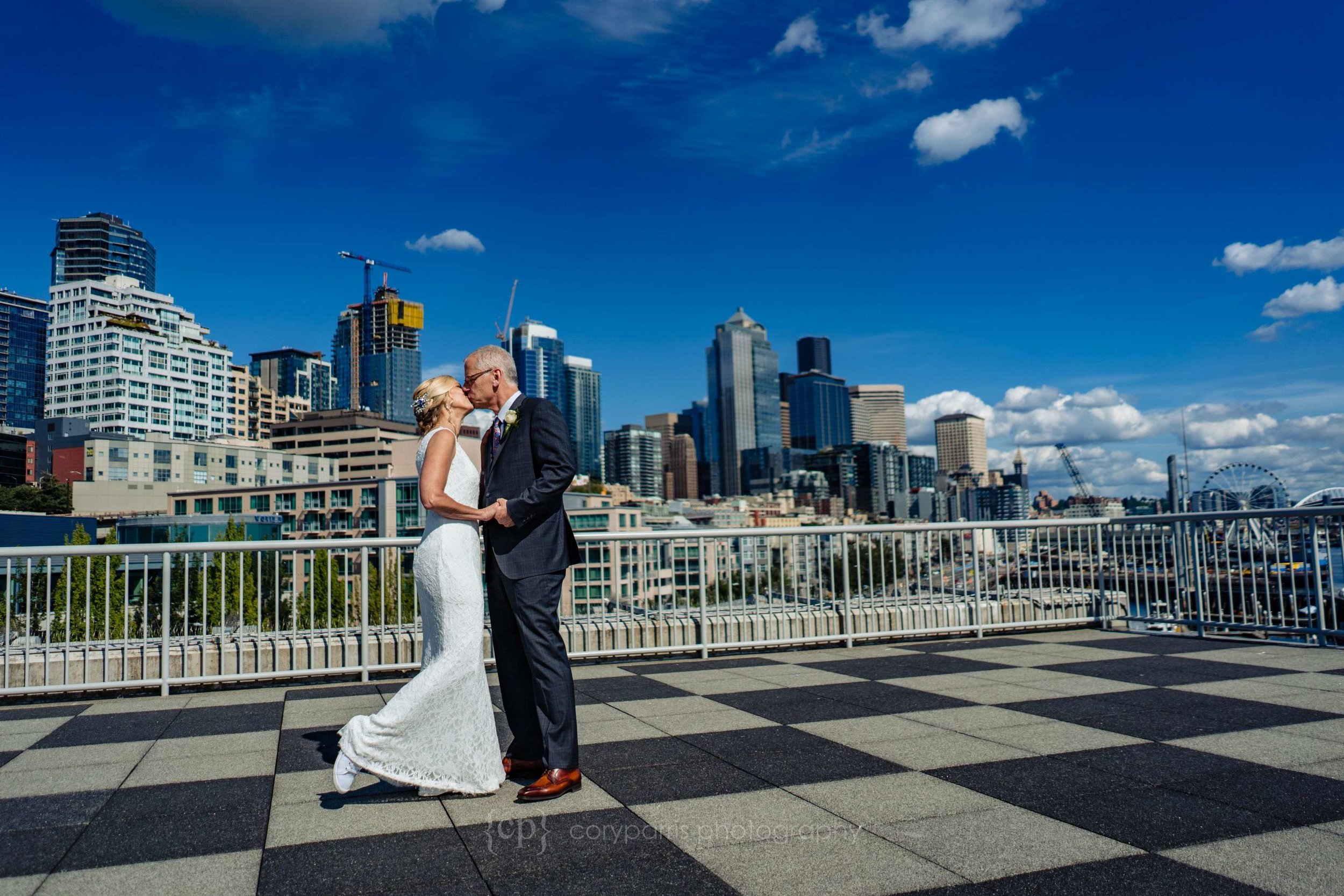 Heather & Bill dancing on the roof of Bell Harbor before their wedding at the World Trade Center Seattle.