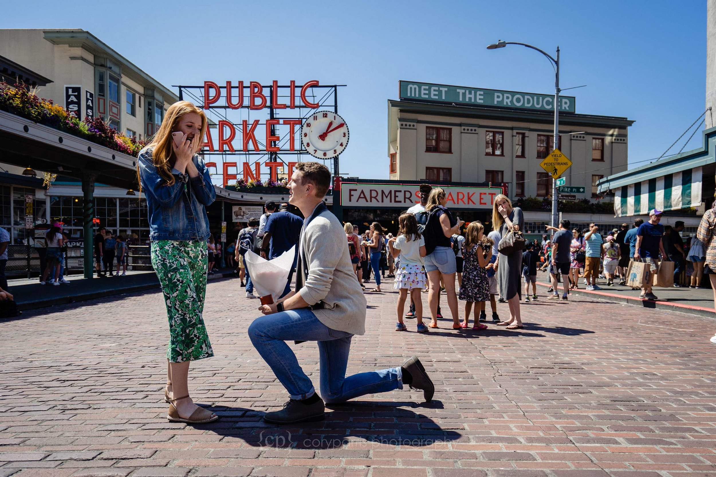 Matt on one knee as Madeline reacts to the proposal