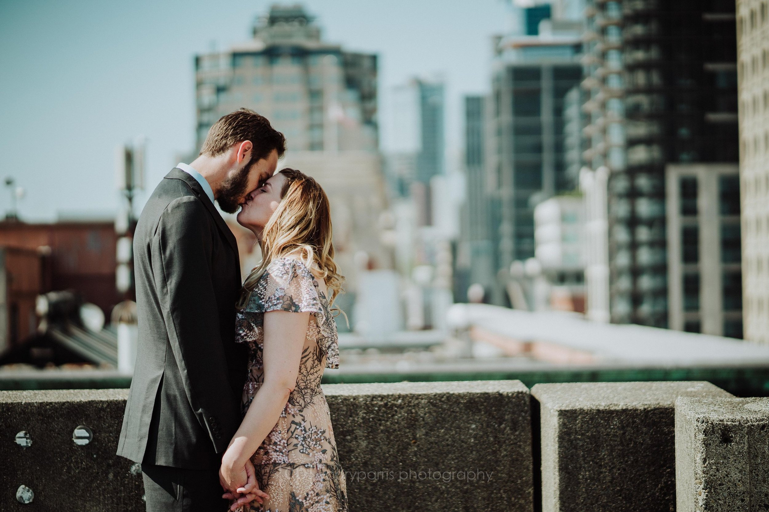 Hailey & Dillon on the top of a parking garage in Seattle before their courthouse wedding.