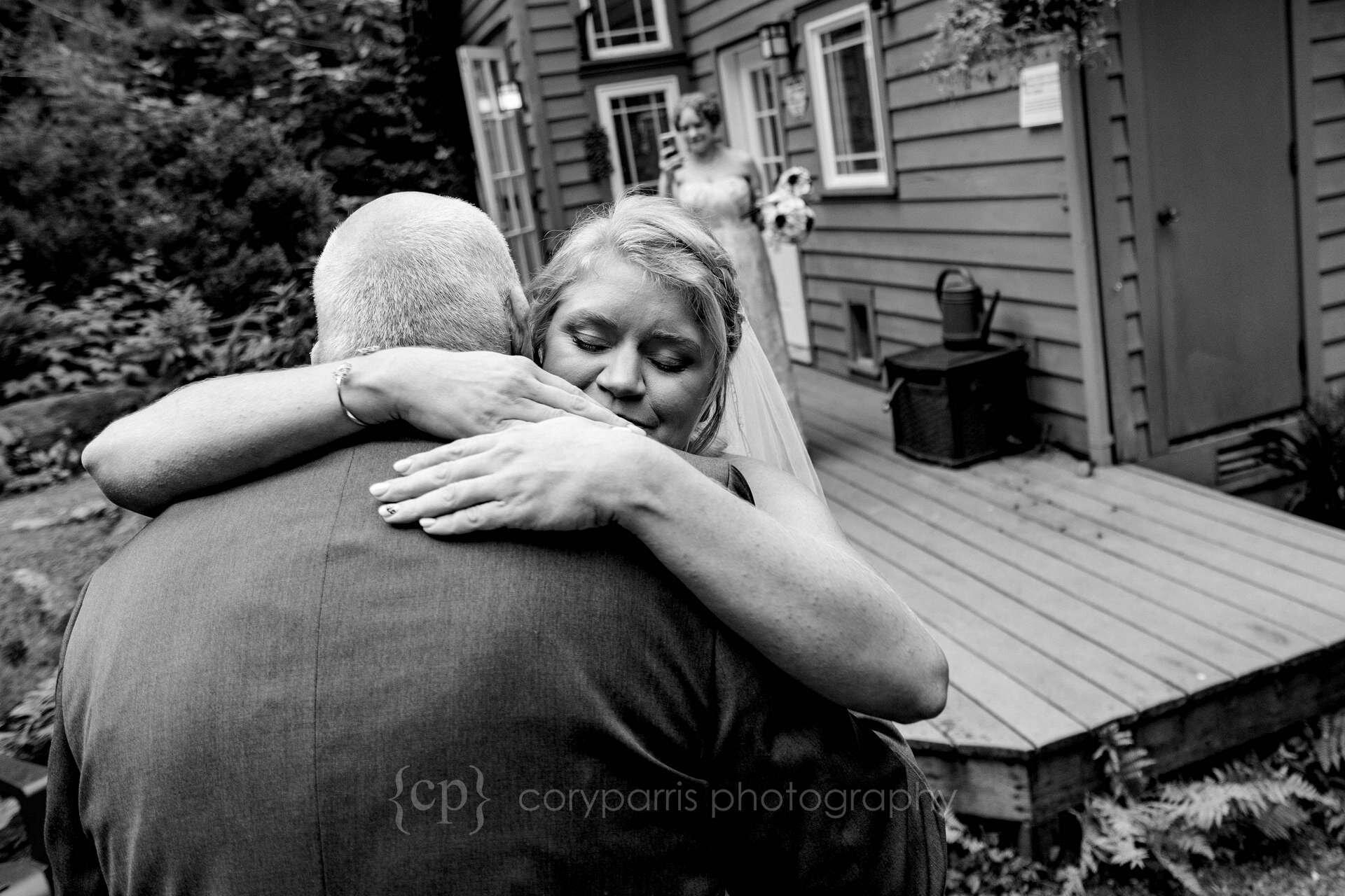 Jessica hugs her dad.