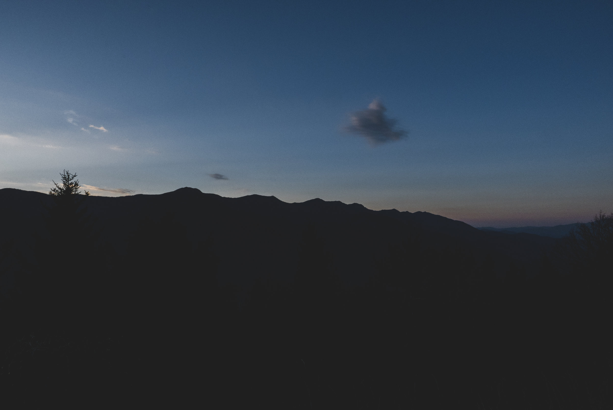 Black Mountain ridgeline. The trail starts in the valley to the right and the Mt. Mitchell summit is just left of frame.
