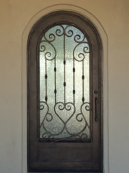 Arched ornamental wrought iron door.jpg