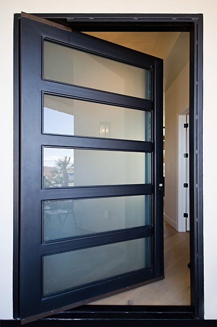 Modern glass panel pivot door.jpg