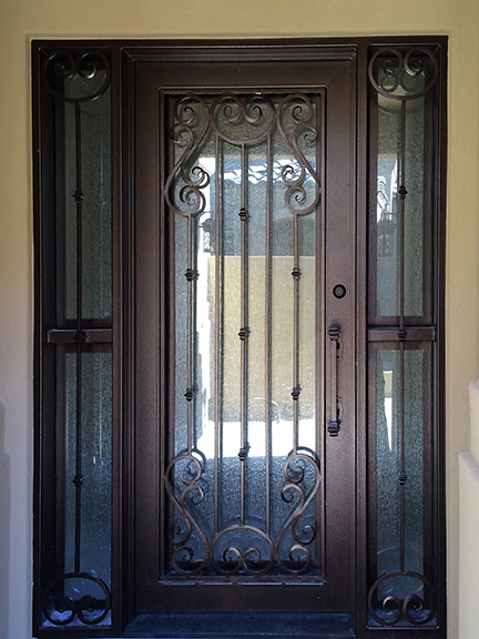 Ornamental wrought iron wit side light door 1.jpg