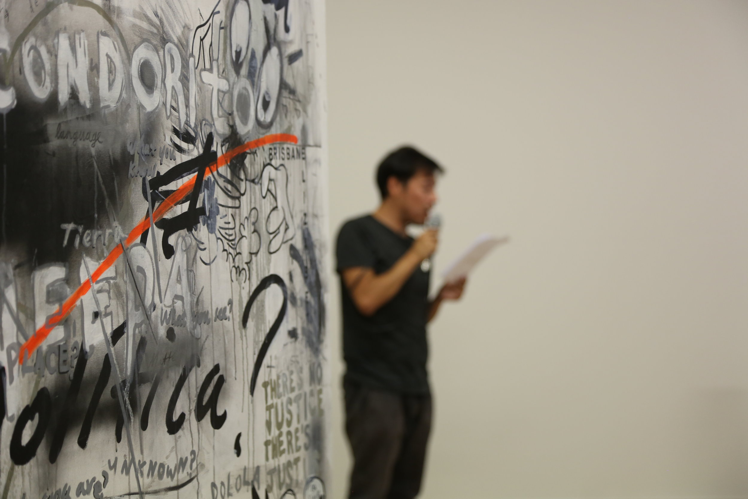 From Left: Robert O'Connor, ¿Donde está la línea entre el arte y la política? (detail of self-standing canvas), 2018, mix media, 240 x 240 cm; Eduardo Cruces, Reconversión-Ruina, Chile-Europa-Tasmania, performative reading, 12'57'', 2011-ongoing (Photo credit: Mat Carey)