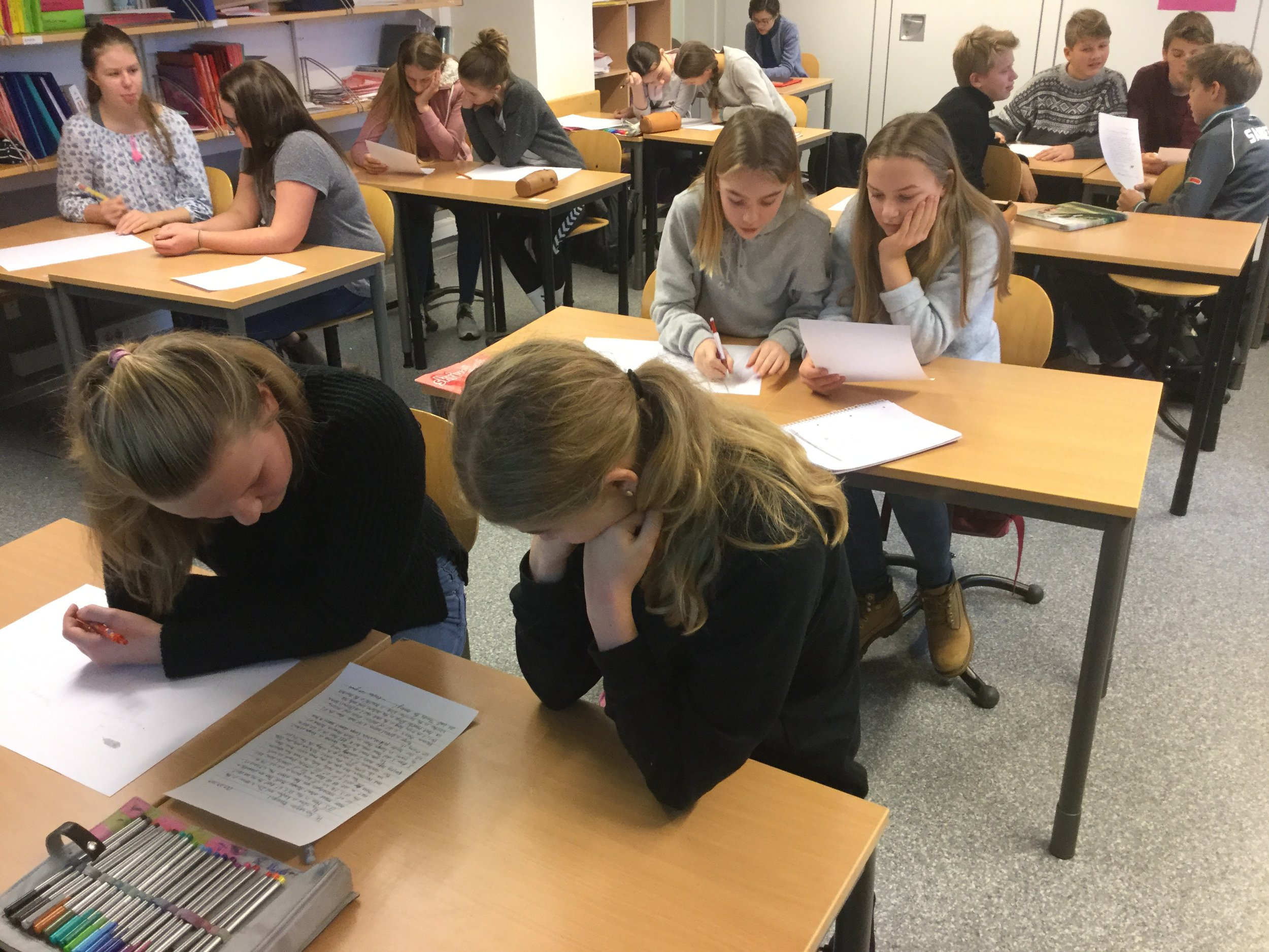 Reading letters from students at Colchester High School in Arendal.