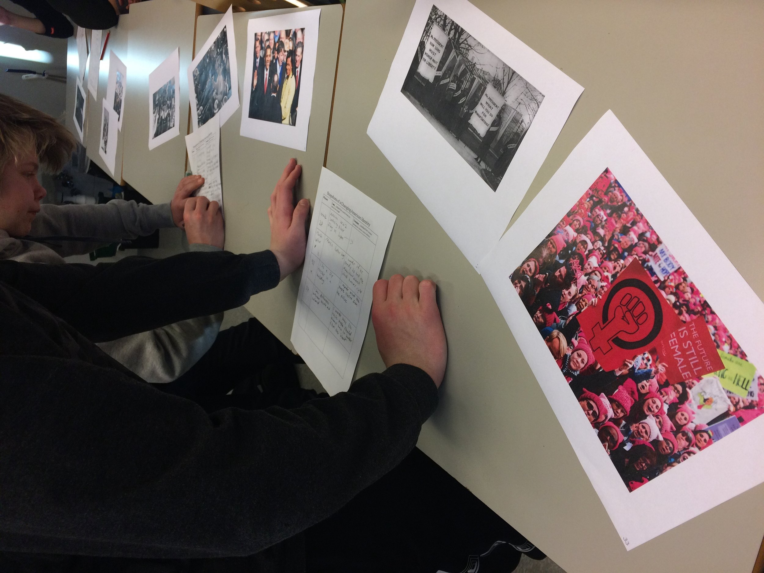 """Students analyze famous photographs from US history in the workshop titles """"Snapshots of a Changing American Identity"""""""