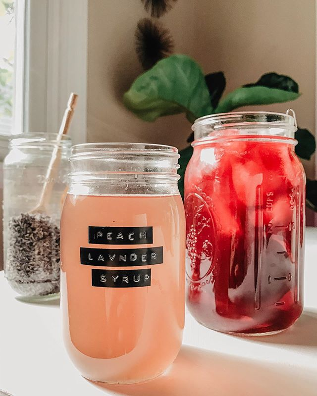 {Peach & Lavender Simple Syrup with Hibiscus Chai Tea!!!} 🍑🌱✨ • I think i've turned into a peach, y'all. Peaches are in season here so you're going to have to bare with me while my entire feed is peach themed.🤷🏻‍♀️ • Recipe for the simple syrup: • Ingredients: • •2 cups water •2 cups white organic sugar •2 large peach- cubed •2 tbsp dried lavender • Method: • 1. Boil 2 cups water. 2. Add sugar, peaches, and lavender and turn down to a simmer. Simmer for 30 minutes. Crush the peaches when they get soft. Stir occasionally. 3. Strain the syrup. Store for up to 2 weeks in the fridge. I'm going to use mine for teas and mixed drinks. • For the tea, I simply steeped half dried hibiscus leaves and half a loose leaf chai oolong I had. ☕️ . . . #sustainableliving #sustainablehome #smallspaceliving #fairtrade #ethicallymade #consiousliving #sustainablestyle #sustainabledesign #thisishome #herbalism #herbalmagic