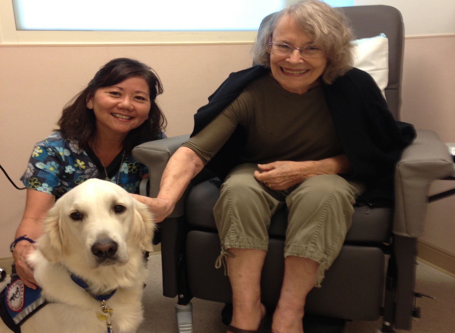 Pat Inada, RN, Yoda, Queen's Therapy Dog, and patient before chemo
