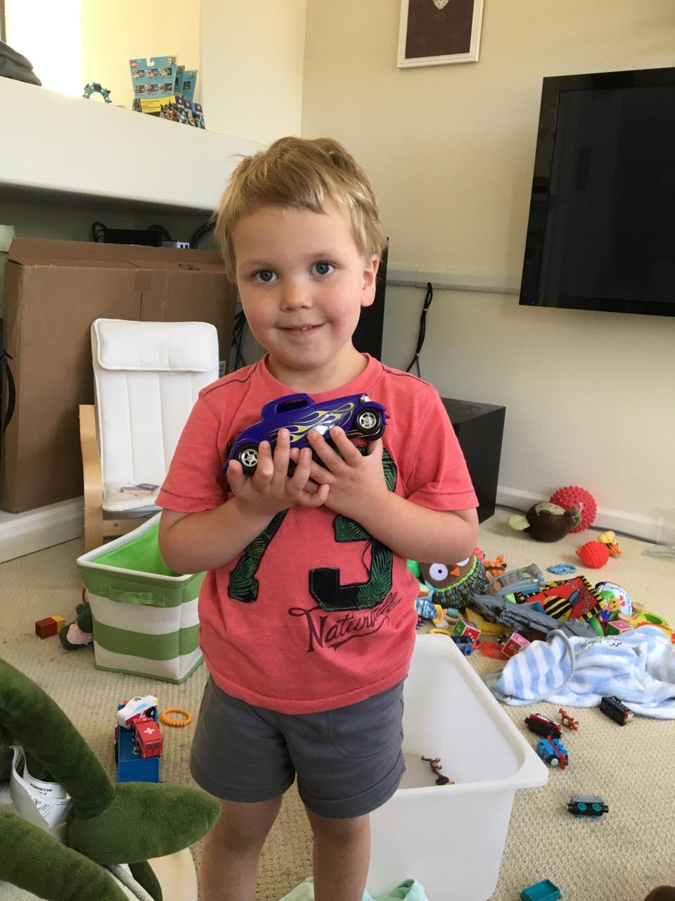 Showing off his model car (June)