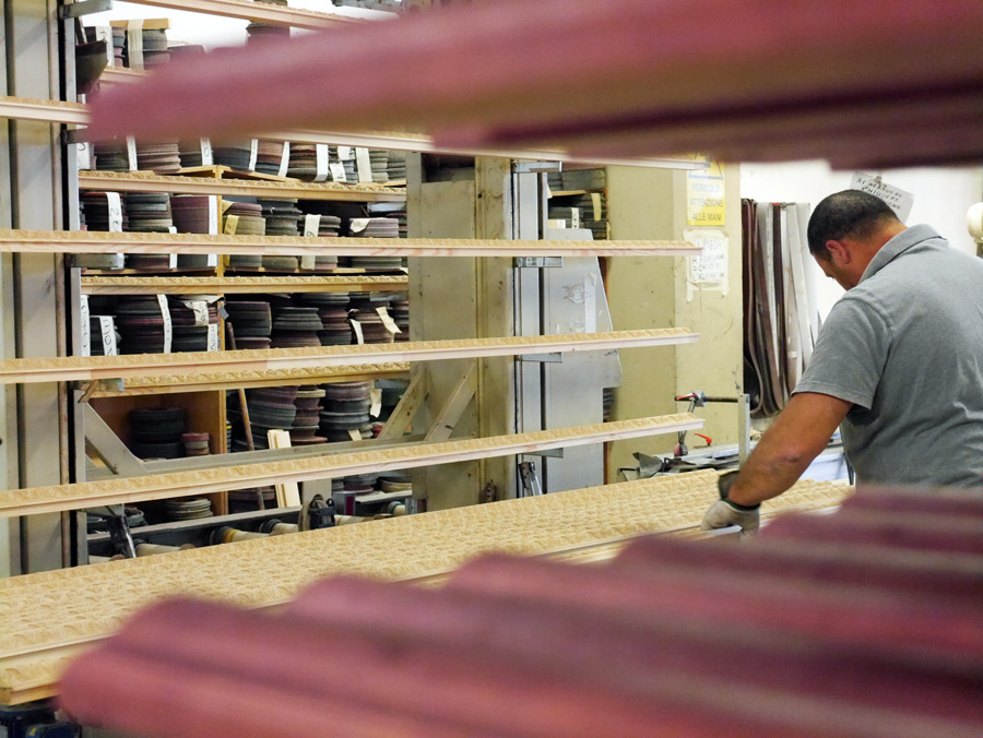 """This is as close to """"mass production"""" as these facilities get! The artisans creating the hand-finishes for the mouldings we buy for Artists Frame Service are undoubtably the best."""