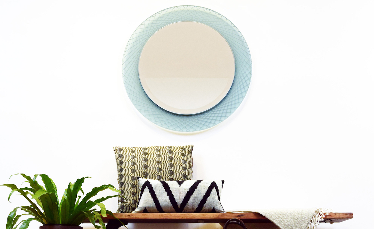 This    Prisma    Spiro mirror showcases a unique radiating circular design in sea glass acrylic with platinum accent color. Imagine the possibilities - we can design any size mirror from any of our    thousands of frame mouldings   .