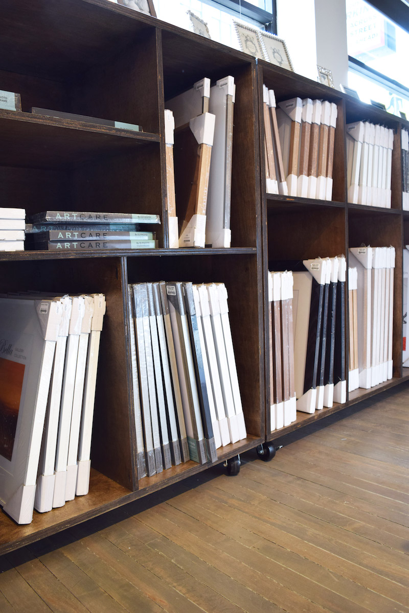 The wide assortment of  gallery frames  was calling our name - prices start at $37 and come in nine different finishes. We selected a slim silver 11x14 frame for $54 and a more substantial oak veneer 16x20 frame for $81.