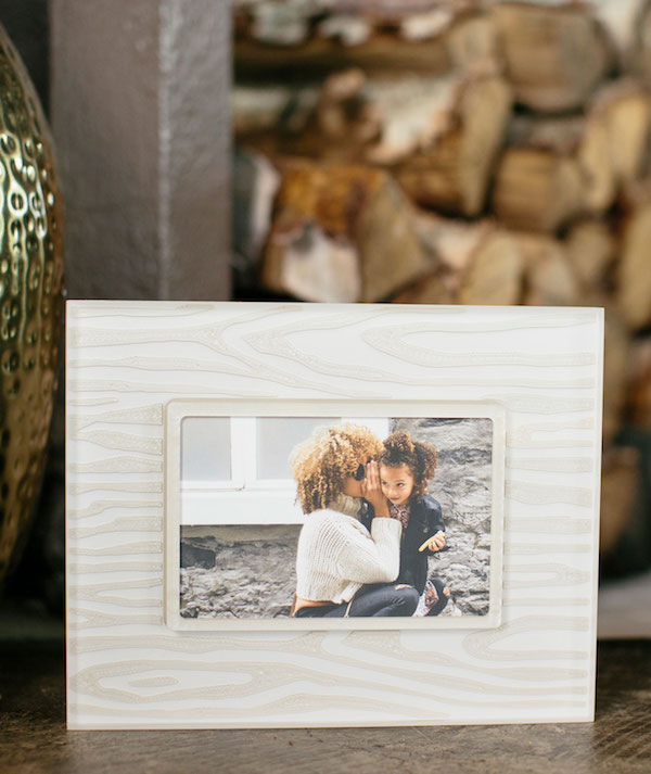 """French for """"false wood"""" - the faux bois pattern on this  Prisma photo frame  originated during the Renaissance and has been popular ever since. It goes well with all decor styles and will make any photo look like a masterpiece.    Faux Bois Snow White and Silver   From $103.00"""