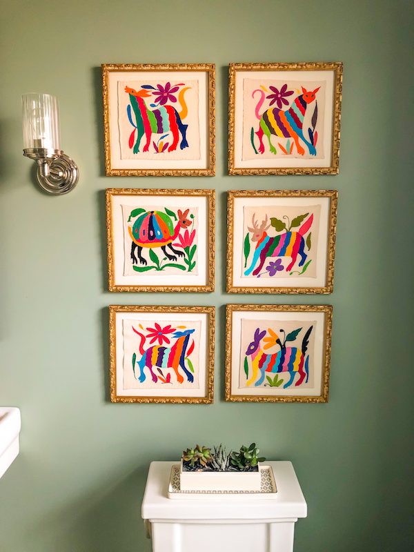 And the textiles have found their forever home! A powder room is the ideal place to get a little funky and creative with art and color. Their small footprint allows you to make bold choices without it feeling overwhelming.