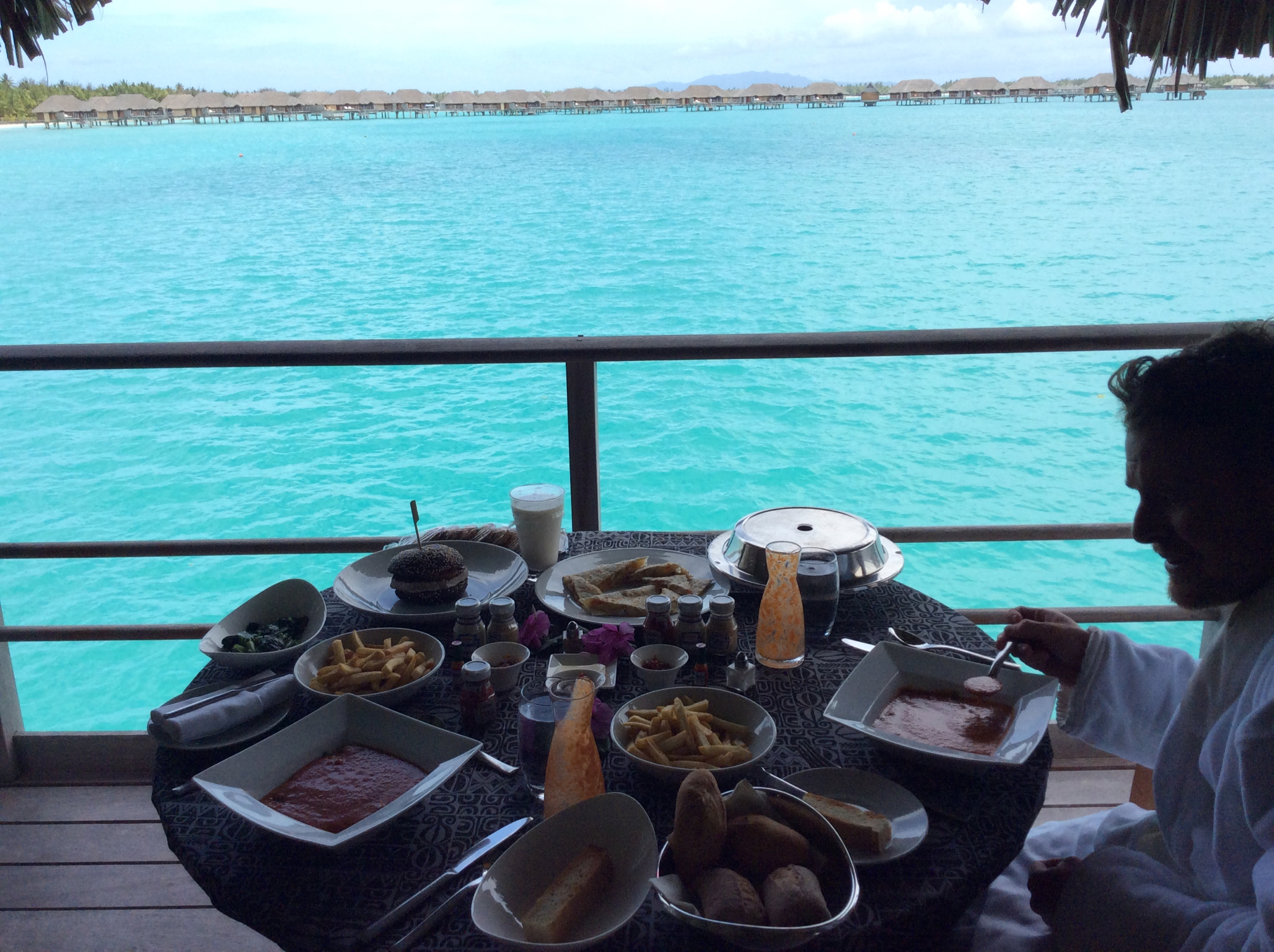Breakfast in bed at our One-Bedroom Overwater Bungalow Suite.