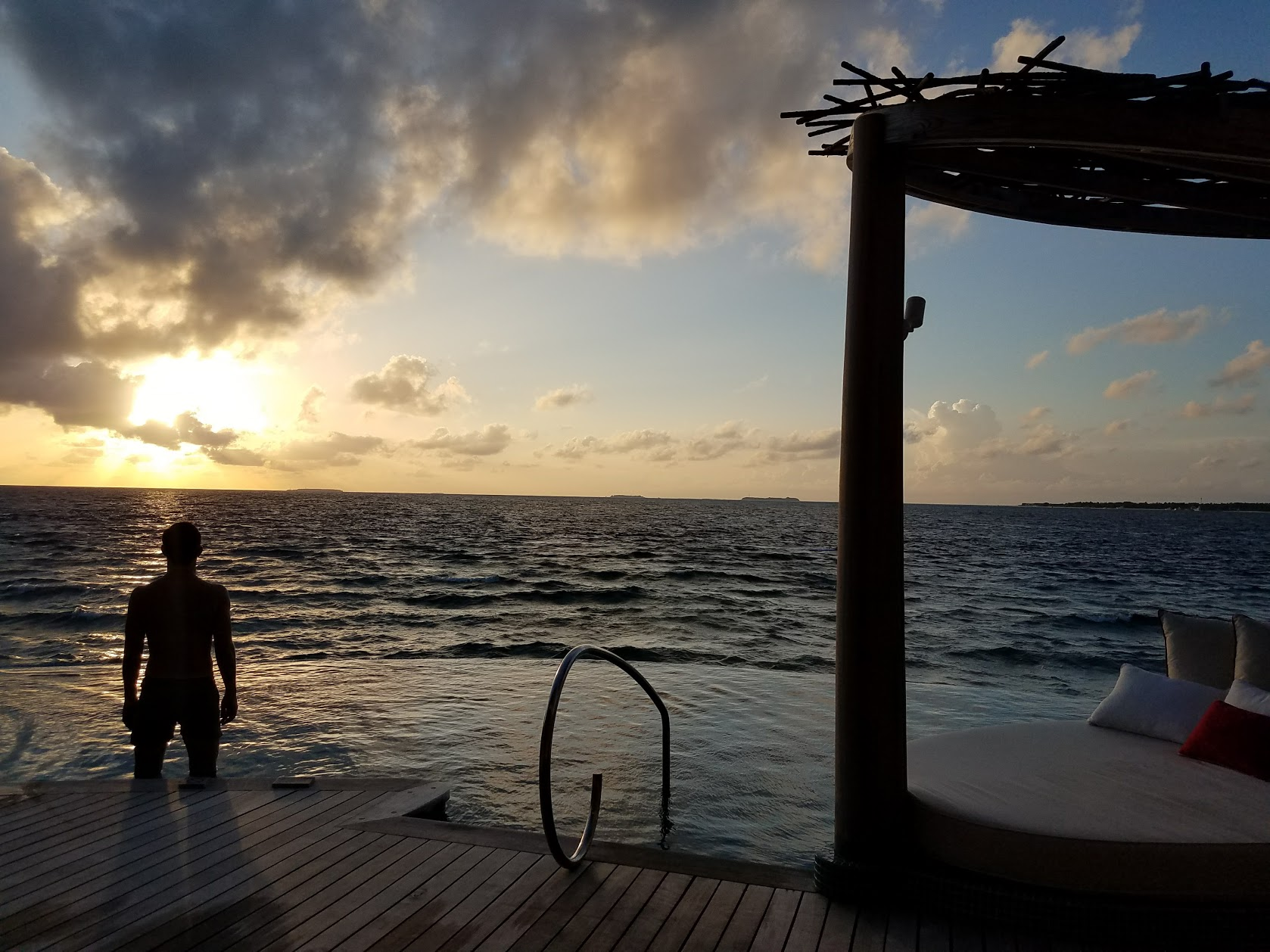 We're dolphin watching around sunset from our overwater villa.