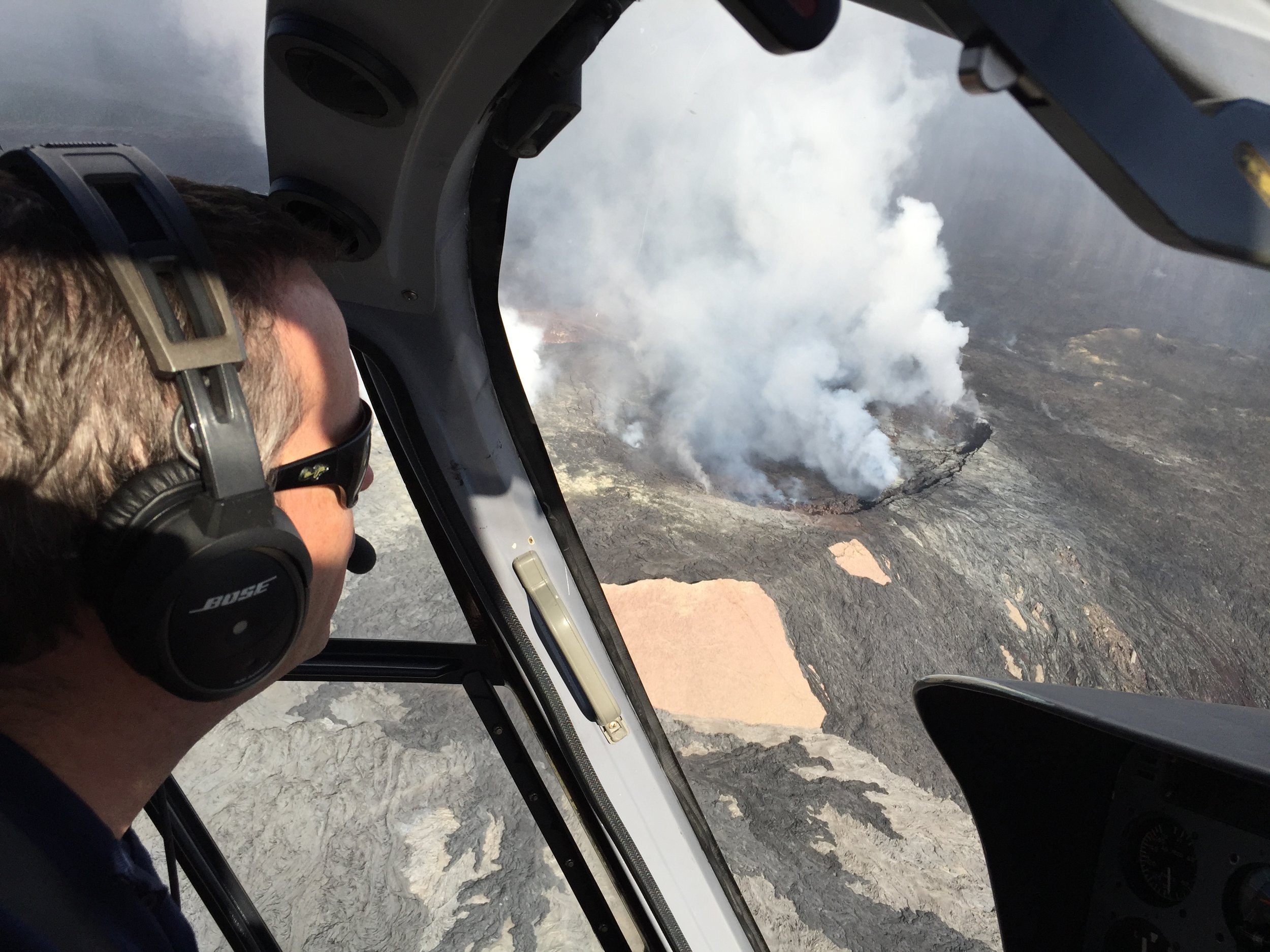 Watching a volcano erupt from a helicopter in Big Island, Hawaii.