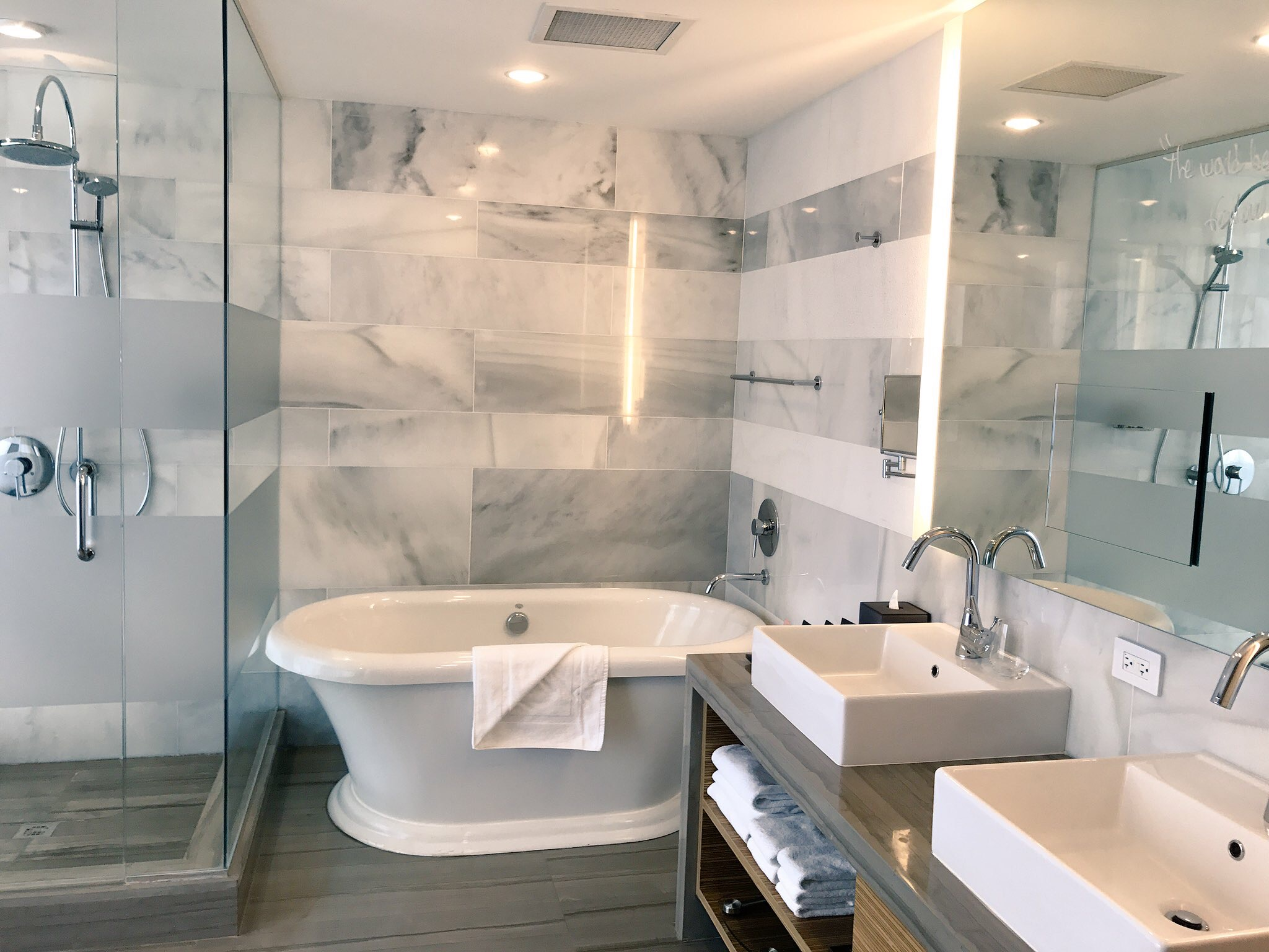 Luxury hotels usually have bathtubs  and  rain showers (and bidets if you're into it).