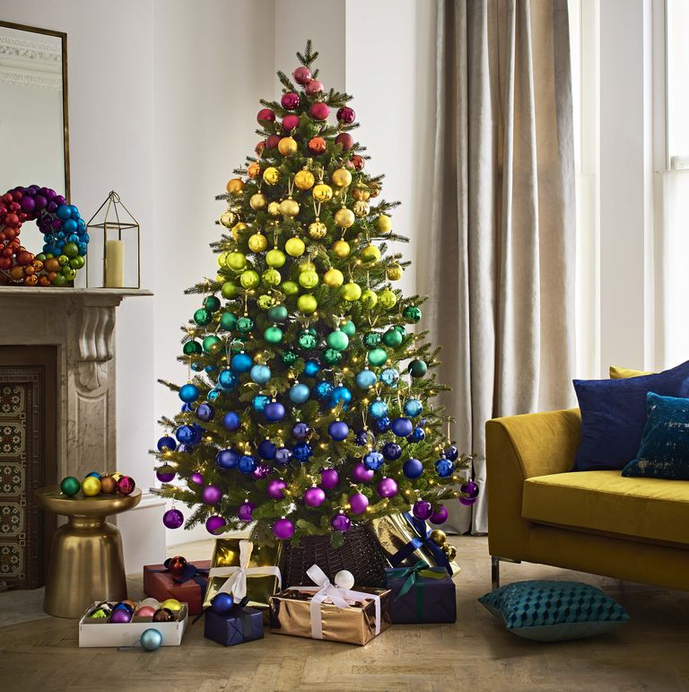 Rainbow - Stunning your house with happy vibes for the year to come is the Rainbow Christmas tree. Rainbows ruled the runways this year with many high-street brands like Primark and John Lewis bringing out collections – many of which were in support of LGBTQ charities – so we love this idea of adorning your tree in a defiant blaze of glory. It's as if a dazzle of unicorns have visited and spread fashion-led festive cheer! Opt for Ombre blocks of colourful decorations, rather than all-over explosion of colour to keep it stylish.