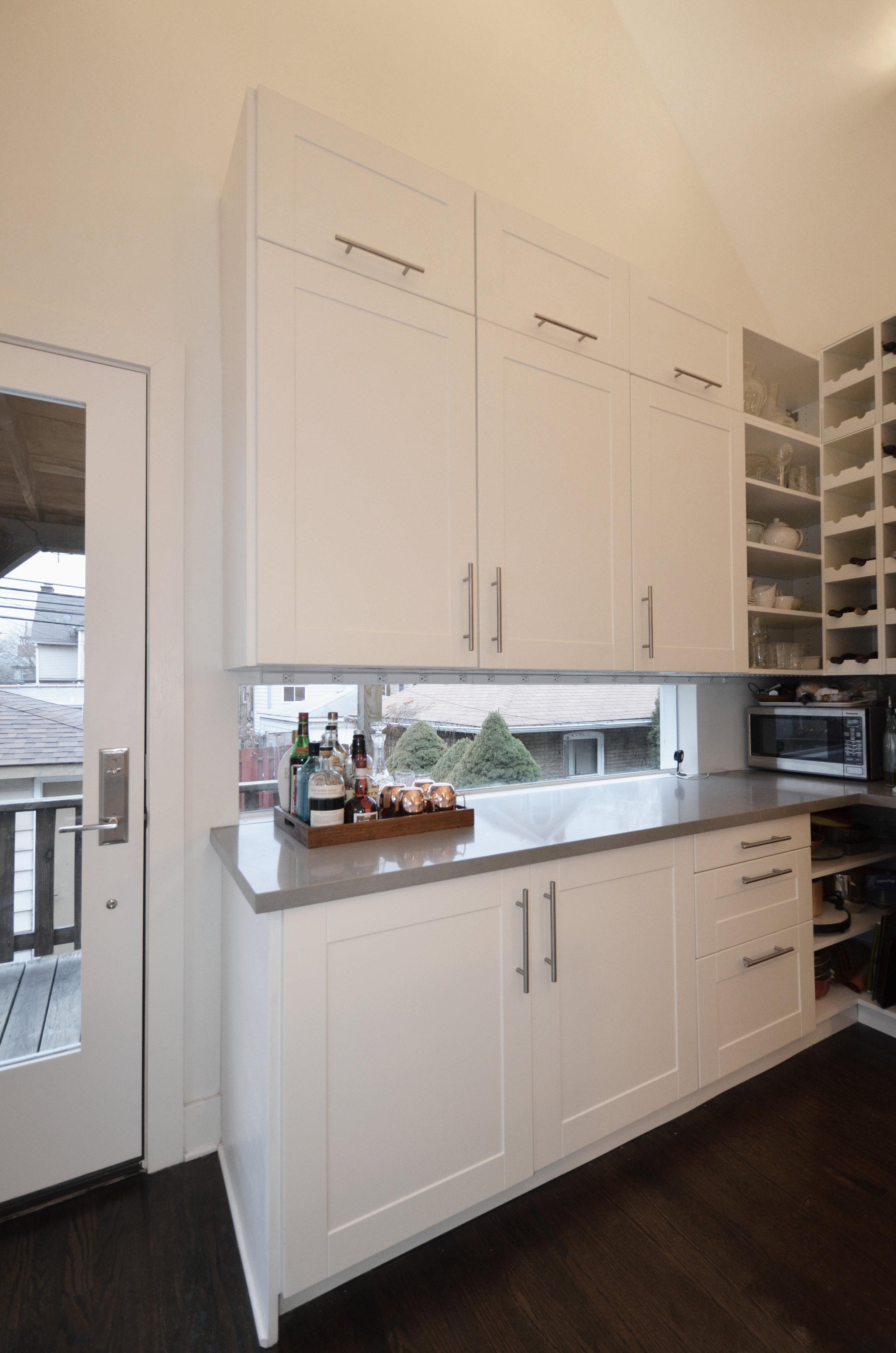 view of kitchen glass backsplash