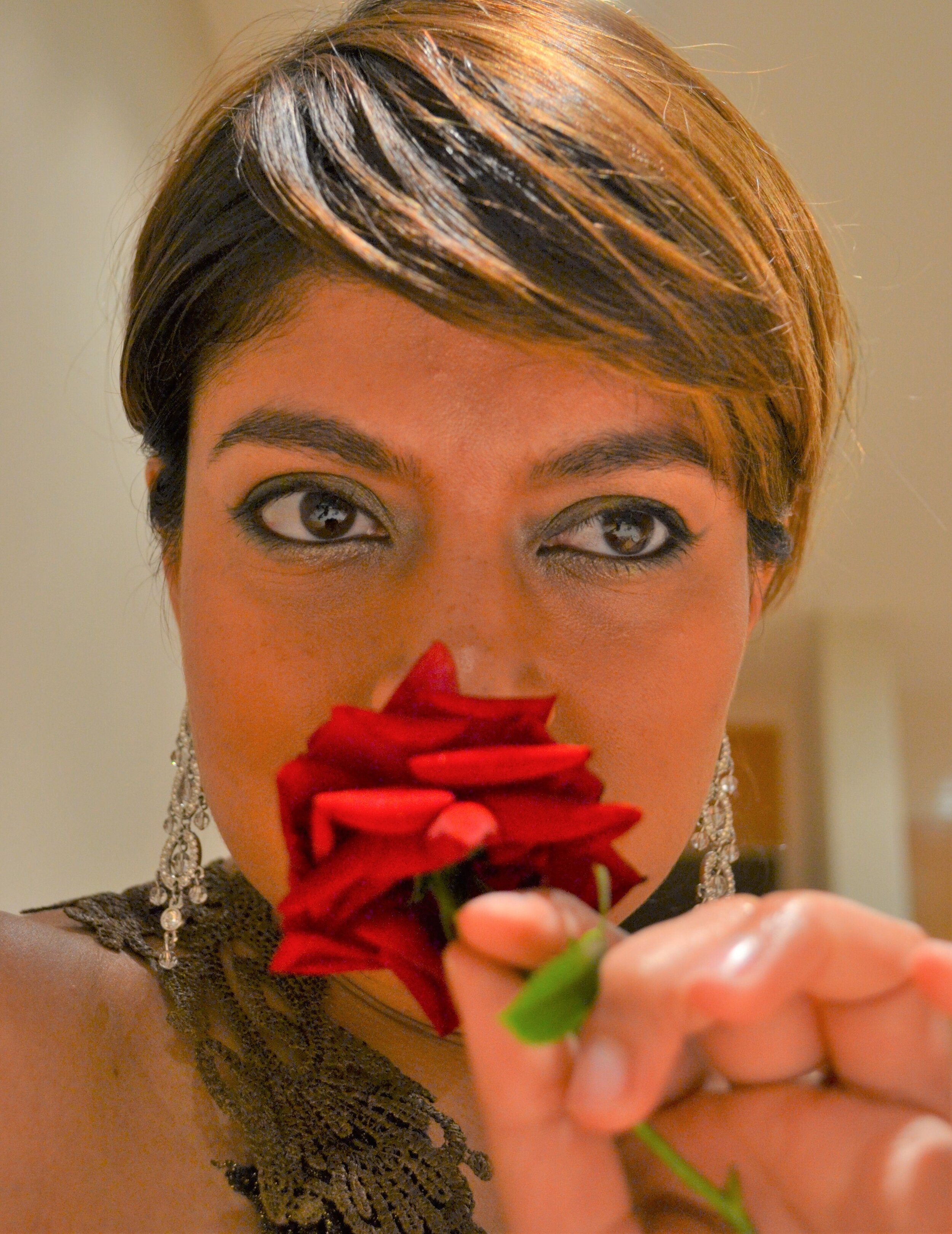 Afreen Age 35 with Holland Etoile rose from her garden. It's a heavenly scent!
