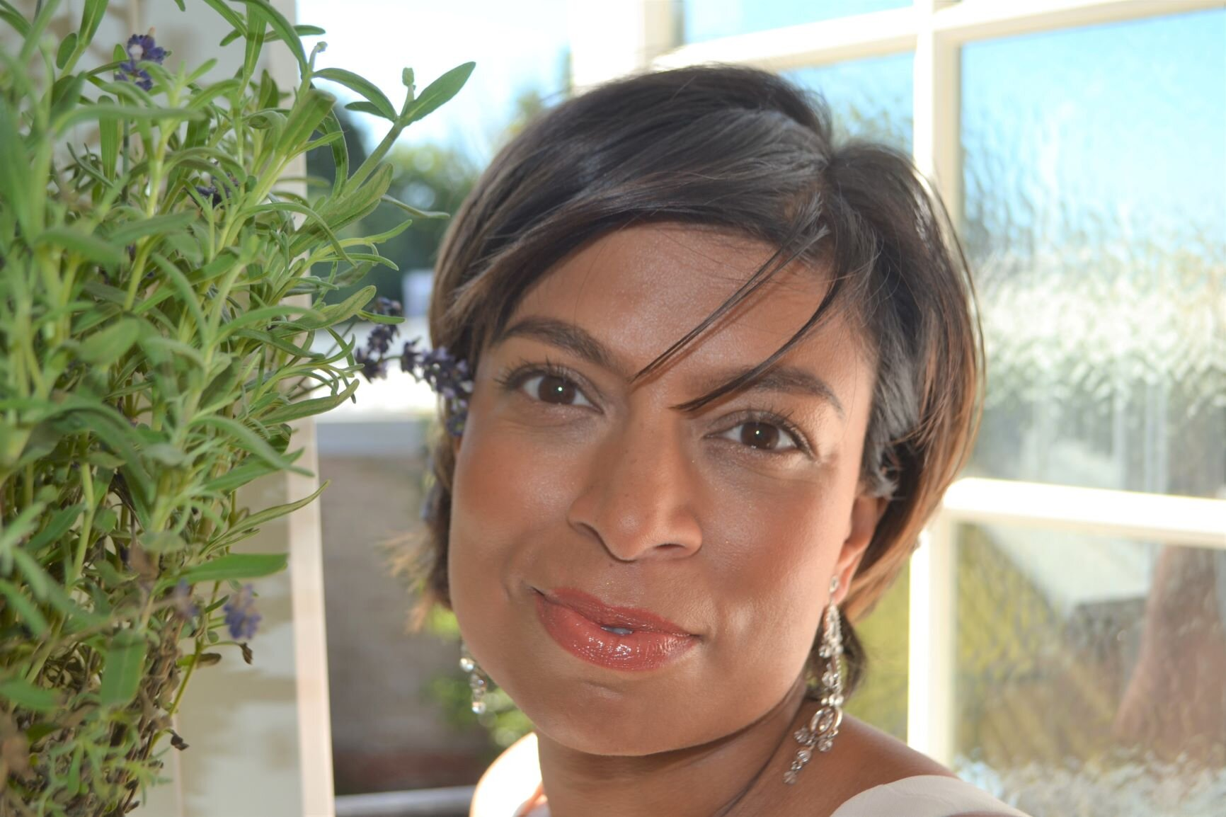 Afreen in her kitchen with her Lavender plant and favourite earrings age 45