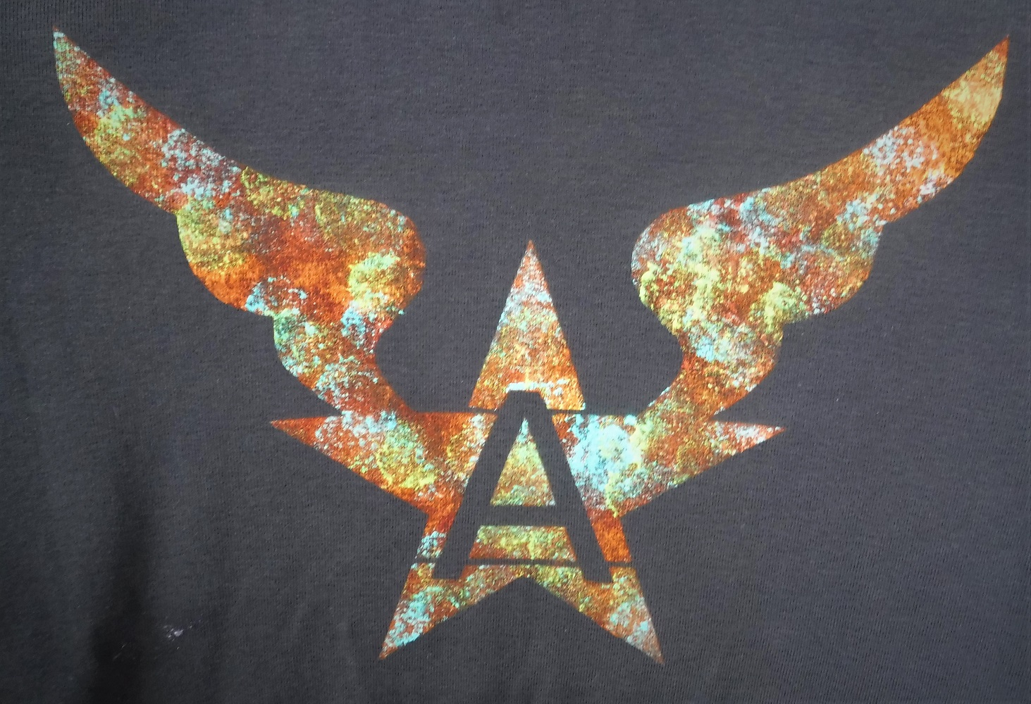 Version 5 on a t-shirt in rusty colours.