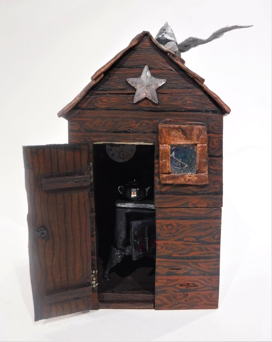 Little Fairy Skeletons cabin door opened wood stove, tea pot.JPG