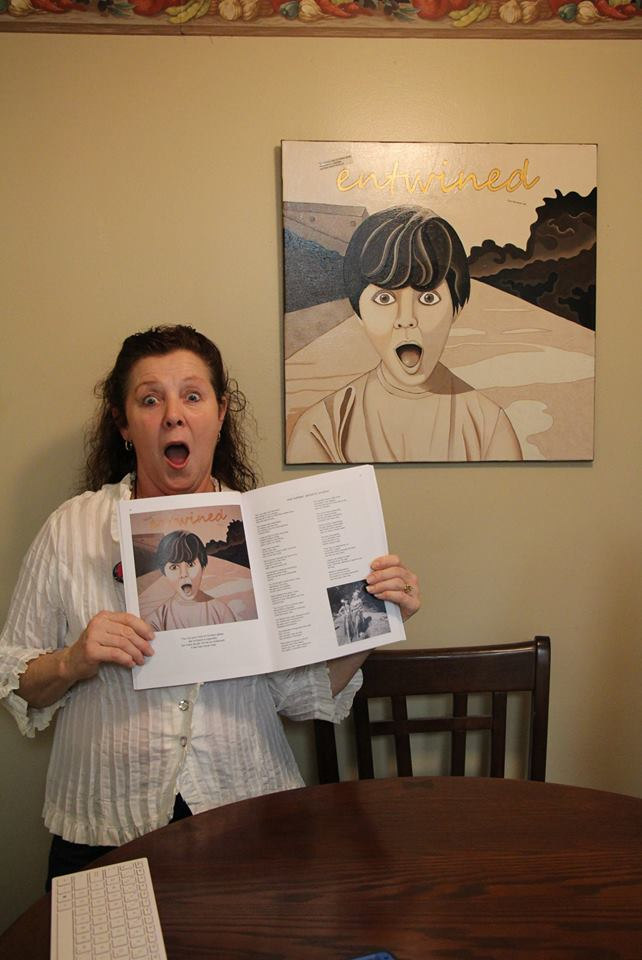 Brenda with the book and her painting..jpg