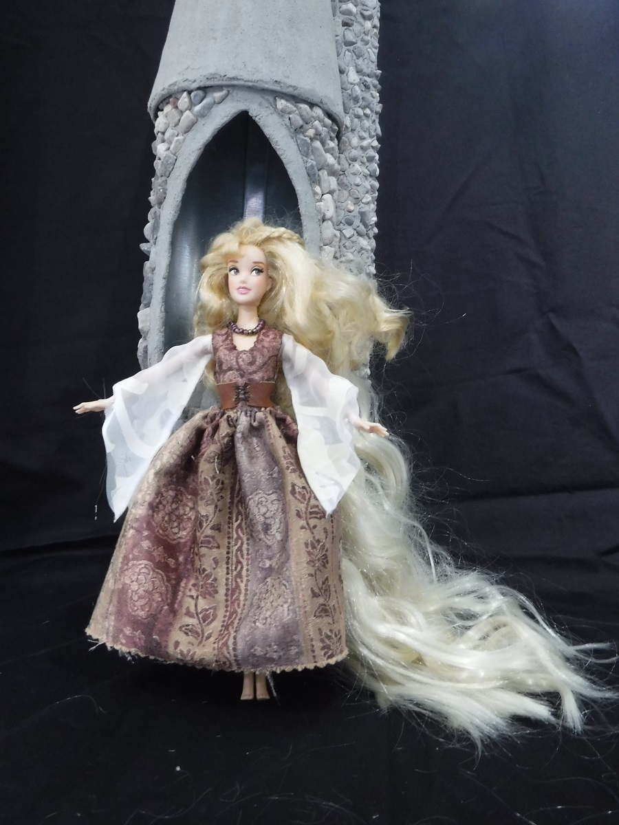 Rapunzel barbiedoll fairy doll.  Dress, hair.  She still needs wings.