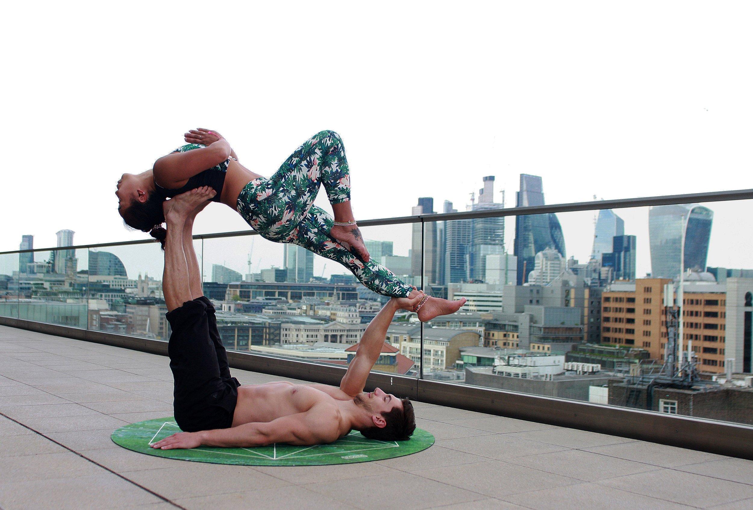 man-lying-down-on-mat-while-lifting-woman-1139489.jpg