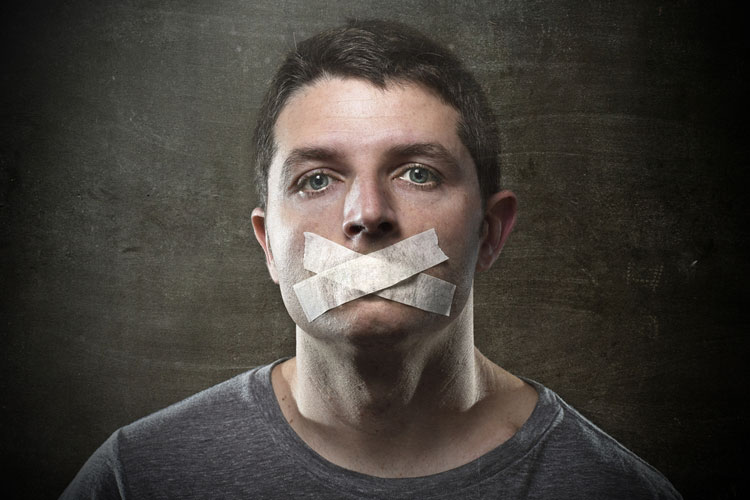 man-with-tape-covering-mouth.jpg