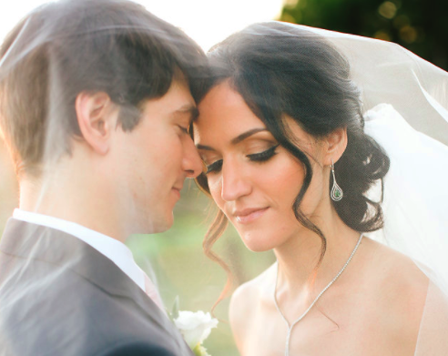 Brunette Bride with Updo Hairstyle and Veil with Husbandin Outdoor Wedding Photos. Bridal hair and makeup by Vanity Belle in Orange County (Costa Mesa) and San Diego (La Jolla)
