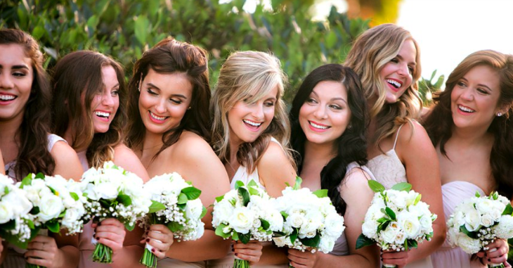 Close-up Wedding Pictures with Bridesmaids Smiling holding Bouquets